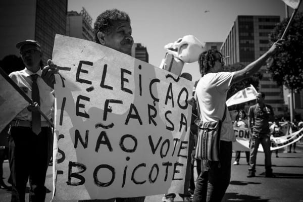 """""""Elections are a farce"""" reads the placard. The feeling that society is sick is pervasive. But it's not so much Dilma's government as the system itself."""