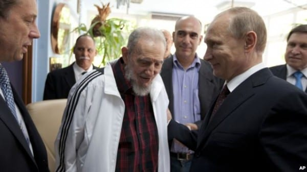Russi'a Pres. Putin greets the legendary leader of Latin American revolution, Fidel Castro, in Havana, during his tour in July 2014.