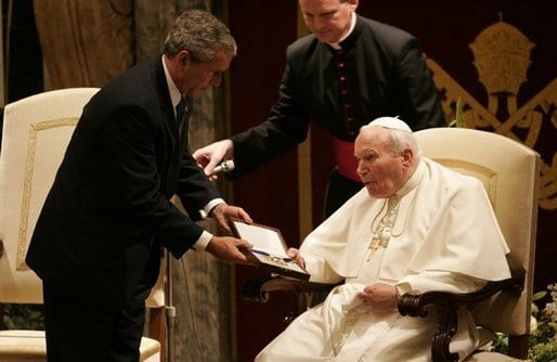 U.S. President George W. Bush presenting the Presidential Medal of Freedom to John Paul II in June 2004