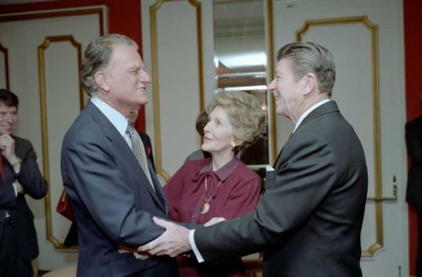"Few charlatans have occupied as spectacular a place as Billy Graham—""the spiritual advisor to presidents—a man who always blessed the imperial crusades as the duty of a pious nation. Here shaking hands with a secular charlatan, Ronald Reagan."