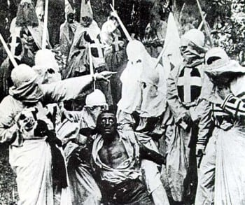 """A """"justified lynching"""" as depicted in Birth of a Nation. The victim to be hanged is a white actor in blackface. (Wikipedia)"""