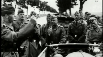 Nazi commandos taling souvenir pictures of their mission on the way into the USSR territories. (Screen grab-TGP)