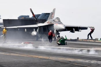 USS Ronald Reagan Sailors prepare jet for takeoff in the Arabian Gulf. Fitting that an attack ship should be named after Reagan, a