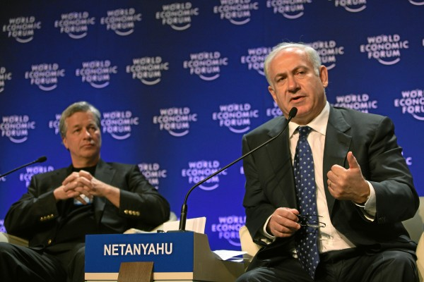 "The obnoxious warmonger Netanyahu blabbering at the World Economic Forum, Davos, as JPMorgan-Chase's Jamie Dimon ""respectfully listens."" (WEF, via flickr)"