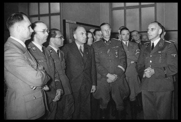 Top Nazis being briefed about operations on the Eastern Front. From left to right: Rudolf Heß, Heinrich Himmler, Philipp Bouhler, Fritz Todt and Reinhard Heydrich, listening to Konrad Meyer at a Generalplan Ost exhibition, 20 March 1941. Apparently the Times and Co. —to their eternal shame—now would like us to believe the peaceloving Third Reich was attacked by the brloodthirsty Russian horde.