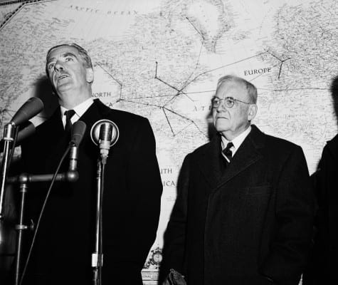 UK's PM Anthony Eden (l) flanked on the right by Eisenhower's State Dept. Secy, the sinister John Foster Dulles, a Wall tweet lawyer. His brother, Allen, ran the CIA.
