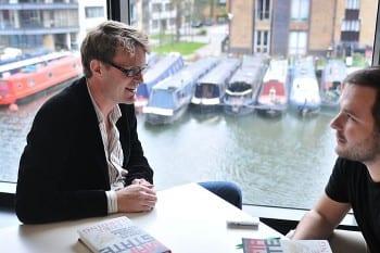 Harding (left) being interviewed. (M.Kucova, flickr)