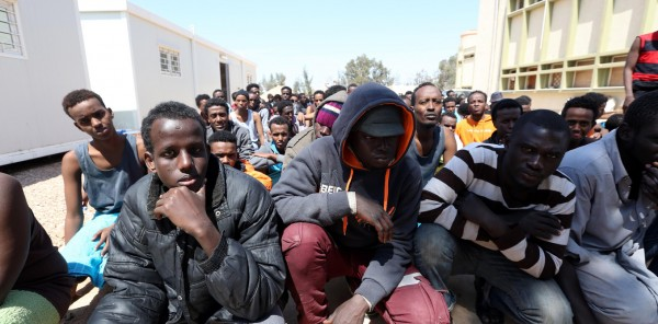 African migrants gather after they were rescued from the sea off the coast of Libya, at a center for illegal migrants in Misrata, Libya, 15 April 2015. An aid group on 15 April said nearly 400 people were still missing from a shipwreck off the coast of Libya, including many unaccompanied children. The boat carrying 550 people capsized on 12 April, while the Italian Coast Guard recovered nine bodies and 144 survivors from the site.  EPA/STR