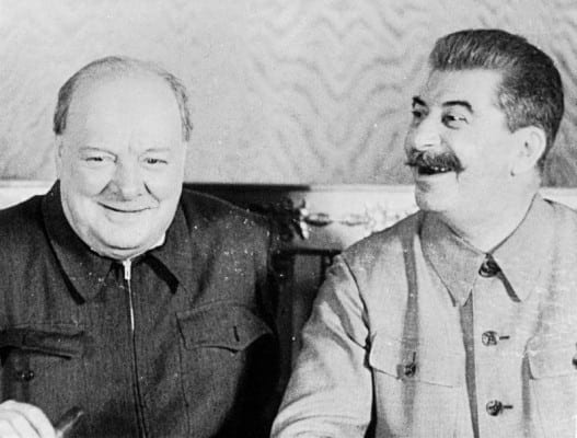 The British Prime Minister Winston Churchill and the Soviet leader Joseph Stalin share a joke in the Krelim, Moscow, in 1942. (MOI) FLM 1117 Part of MINISTRY OF INFORMATION FILM STILLS COLLECTION