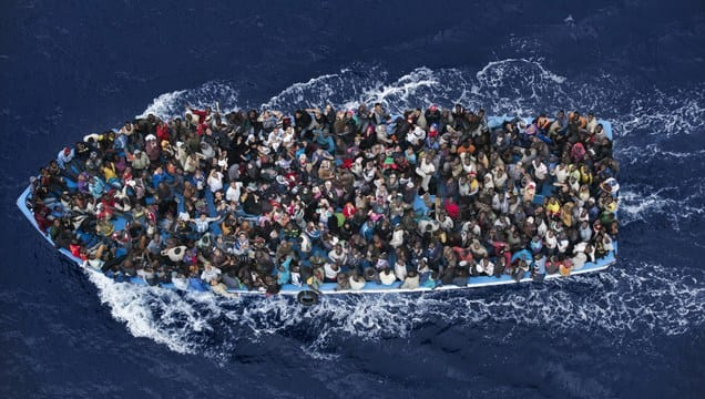 This boat is so crowded that it's hardly visible.