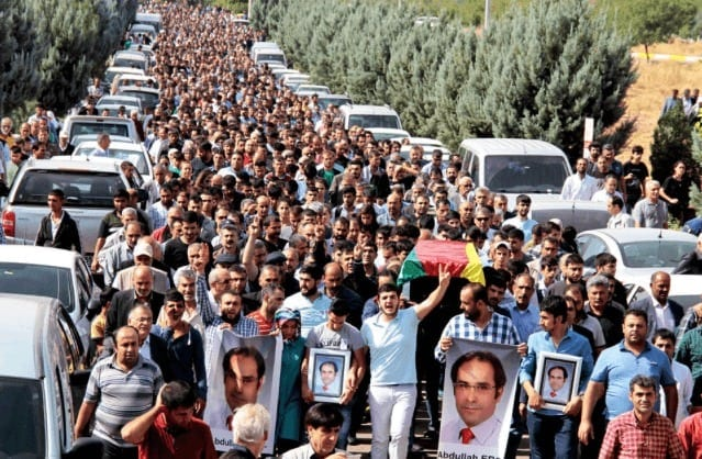 Procession carrying the coffin of Abdullah Erol, a victim of the bomb blasts in Ankara, during a funeral ceremony in the Kurdish dominated southerneastern city of Duyarbakir, Turkey, Oct. 12, 2015.