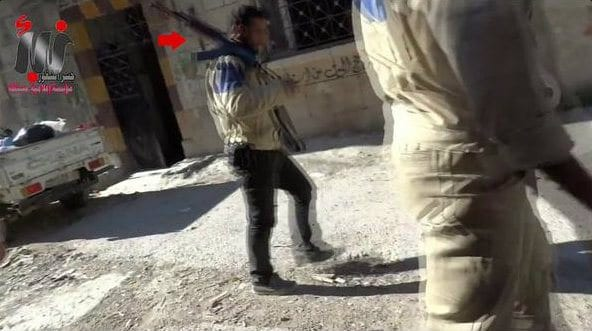 ARMED: Screenshot from video shot in Aleppo clearly showing White Helmet members automatic combat rifles.