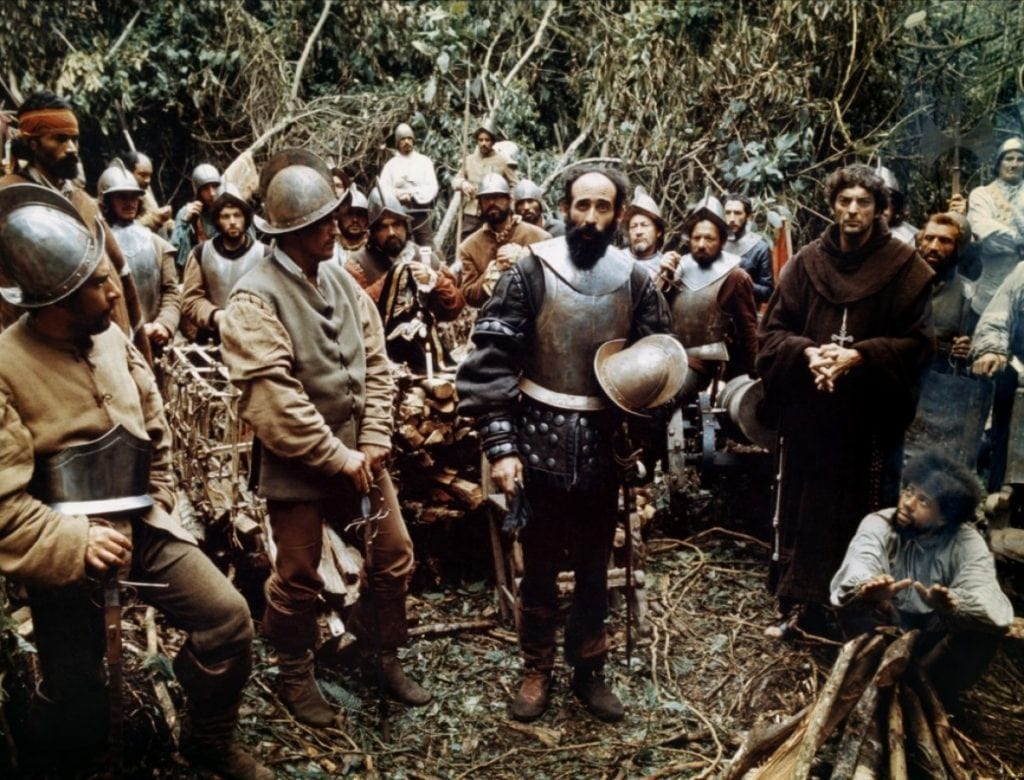 "The Spanish Conquistadors fanned themselves across the Americas ""in the name of Christ and the King""."