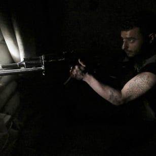 "AMERICAN PROXY: A ""moderate rebel"" fighter takes position behind sandbags in Aleppo's Al-Ezaa neighbourhood – May 20, 2015. REUTERS/Hosam Katan"
