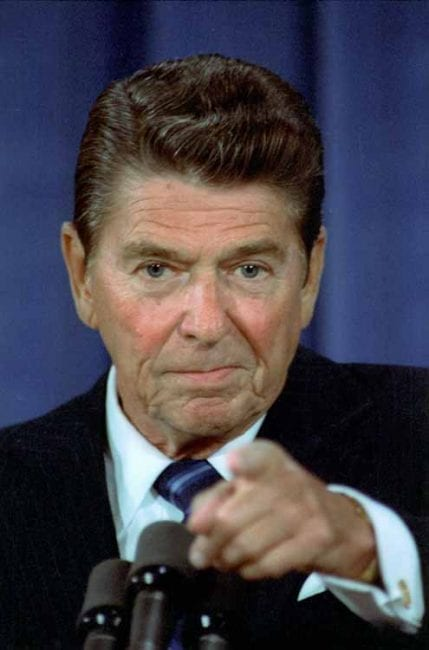 Reagan at work during a pseudo press conference. Since Truman, at least, all US presidential press conferences are carefully staged events for the consumption of the clueless. They are formulas to maintain the illusion of accountability.