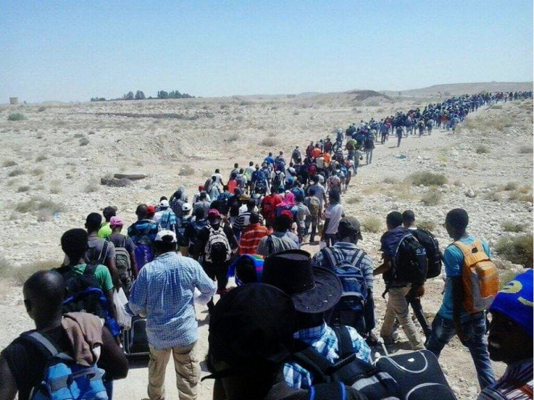 Eritrean refugees leave camp in Israel.