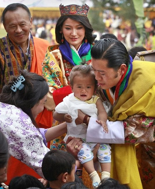 """Bhutan's king in a photo op: Modern monarchs try to act like """"democratic politicians."""""""