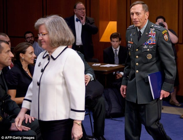 Wife Holly and Petraeus entering congressional hearing.