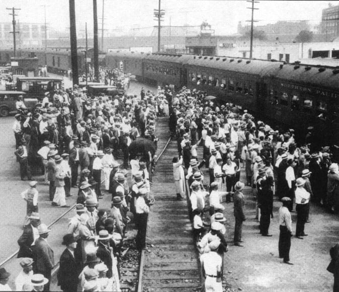 """Mexicans boarding trains for """"repatriation"""" to Mexico in 1931. Many were born in the USA."""