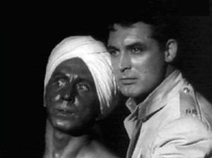 Sam Jaffe portrayed the pathetic Gunga Din, whose chief aspiration in life was to serve the British empire. (Still from the film, with Cary Grant).