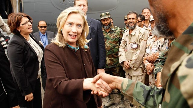 """Hillary greeting the imaginary """"moderate"""" rebels used in the overthrow of Gaddafi."""