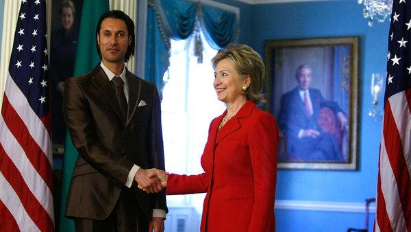 Clinton shaking the hand of one of Gaddafi's sons, whom she later caused to be murdered.