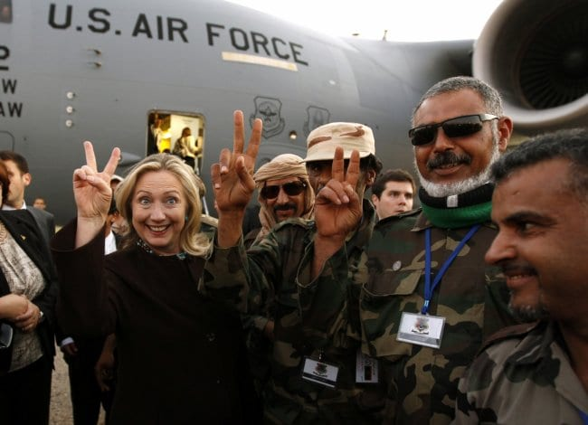 """Hillary in photo-op with the Libyan rebels—""""the Libyan opposition""""—the usual patsies and mercenaries that do Washington's dirty work."""