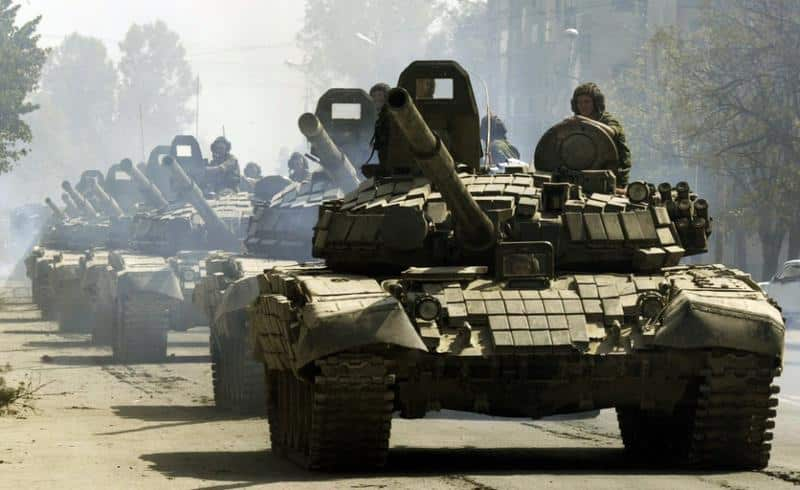 "Russian tanks drive through Tskhinvali, the regional capital of Georgia's breakaway province of South Ossetia, moving to the Russian border, Saturday, Aug. 30, 2008. Georgia has severed diplomatic ties with Moscow to protest the presence of Russian troops on its territory, and its president cast the far-confrontation over his country's fate as ""a fight between the civilized and the uncivilized worlds."" (AP Photo/Dmitry Lovetsky)"
