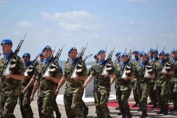 """Irish Army soldier peacekeepers while serving with UNIFUL in Lebanon on September 19, 2013. Na href=""""https://www.flickr.com/photos/dfmagazine/9840610256/sizes/l/"""">Irish Defence Forces. (CC BY 2.0)"""