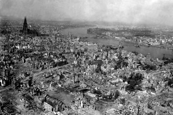 Cologne Cathedral stands undamaged while entire area surrounding it is completely devastated. Railroad station and Hohenzollern Bridge lie damaged to the north and east of the cathedral. Germany, April 24, 1945. T4c. Jack Clemmer. (Army) NARA FILE #: 111-SC-206174