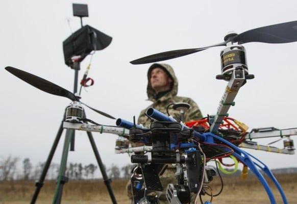 A NATO-sponsored Ukrainian serviceman operates a drone during a training session outside Kiev, November 6, 2014.