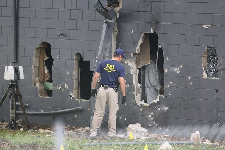 The police blew part of the club's bathroom to gain access.