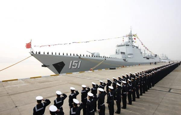 In this Thursday, Dec. 26, 2013 photo, Chinese People's Liberation Army navy personnel salute in front of a new Type 052C guided missile destroyer Zhengzhou during its commission ceremony in Zhoushan, in eastern China's Zhejiang province. (AP Photo) CHINA OUT