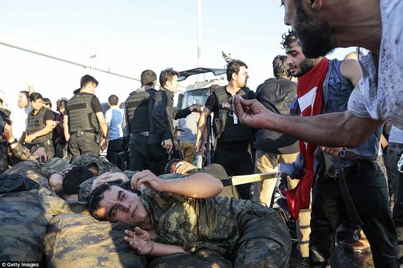 Erdogan mobs menacing surrendered soldier How many ties have we seen a putchist soldier cowering like this? What's really going on here?
