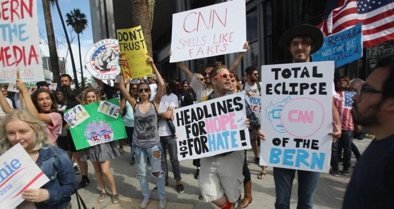 Bernie supporters protest media bias.