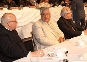 "Chagoury, center in white suit, attending one of the many ""social gatherings"" on behalf of the Clintons, during which crooks request and receive political favors from professional politicians."