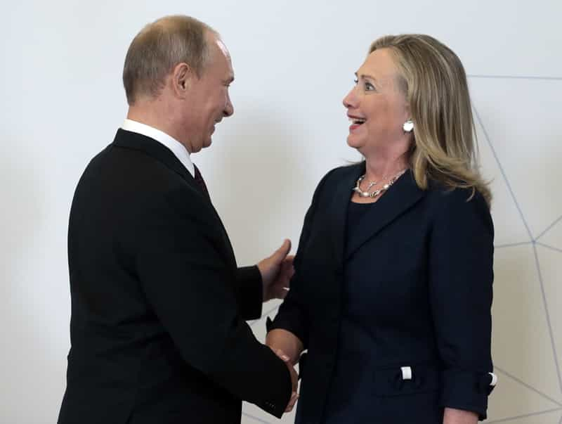 Russian President Vladimir Putin (L) welcomes US Secretary of State Hillary Clinton during the Asia-Pacific Economic Cooperation (APEC) Summit in Russia's far eastern port city Vladivostok on September 8, 2012. Australian AFP PHOTO / POOL (Photo credit should read MIKHAIL METZEL/AFP/GettyImages)