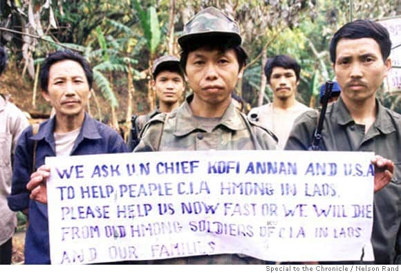 HISTORIC PHOTO: Former soldiers of a CIA-backed 'secret' army that fought communist forces in Laos during the Vietnam War hold up a sign pleading for US and UN help. The soldiers never surrendered in 1975 and have been fighting a low-level insurgency for the past 29 years. They are currently surrounded by Laotian forces and are convinced that unless urgent action is taken to help them, they will all die. Picture takenÊat the group's headquarters in Xaysomboune Special Zone, northern Laos, in April 2004. Special to the Chronicle / Nelson Rand PHOTO CREDIT: NELSON RAND/SPECIAL TO THE CHRONICLE