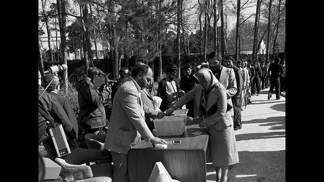 Iranians vote for the establishment of Islamic Republic in 1979.